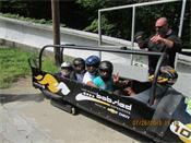 George Jordan family in bobsled at Ironman® Lake Placid