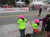 The Jordan's watch the race fro the sidelines at Ironman® Lake Placid