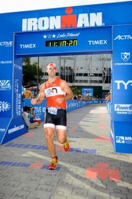 Joe Manning crosses the finish line at Lake Placid 2013