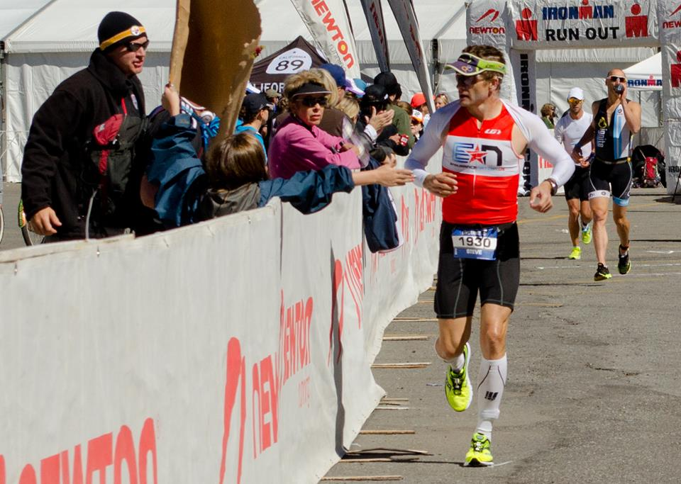 Steve Hall meets his family on the run during 2013 Ironman® Lake Tahoe