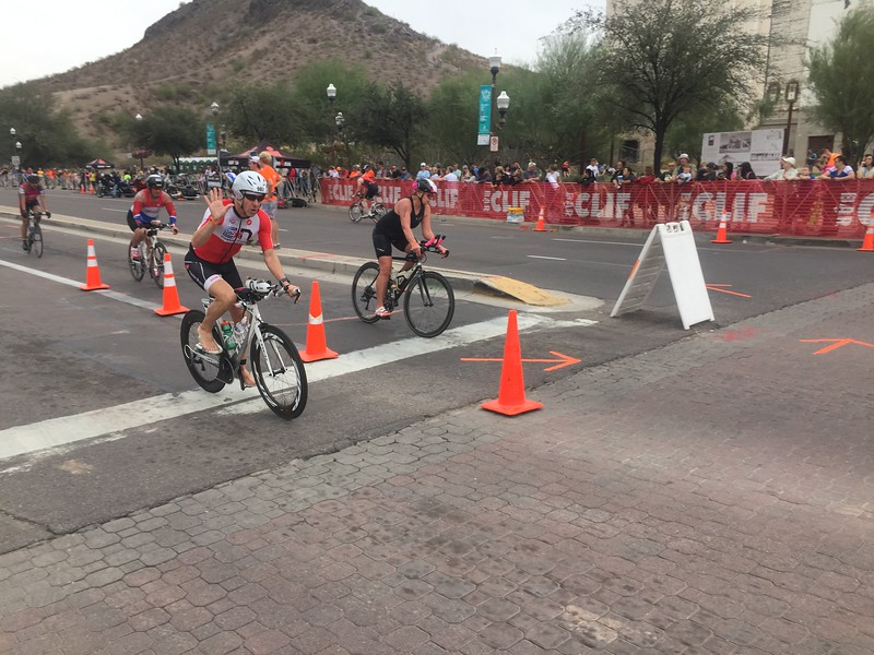 Bruce Thompson finishing the bike and on his way to a 2nd place finish in M60-64, and sub 11:00 PR!
